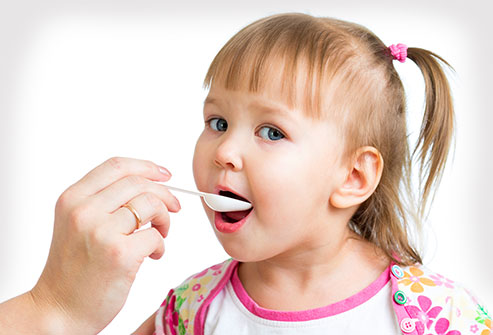 istock_rf_child_taking_suppliment_from_spoon